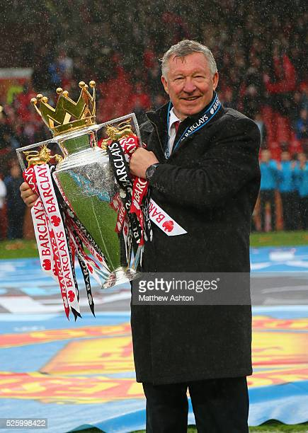 Sir Alex Ferguson the head coach / manager of Manchester United with the Barclays Premier League trophy