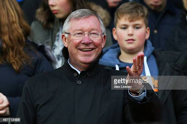 Sir Alex Ferguson the manager of Great Britain and Ireland waves to the fans during the David Beckham Match for Children in aid of UNICEF between...