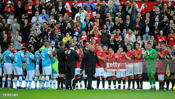 Sir Alex Ferguson walks out to a guard of honour to after 25 years as Manchester United manager is displayed outside the ground before the Barclays...
