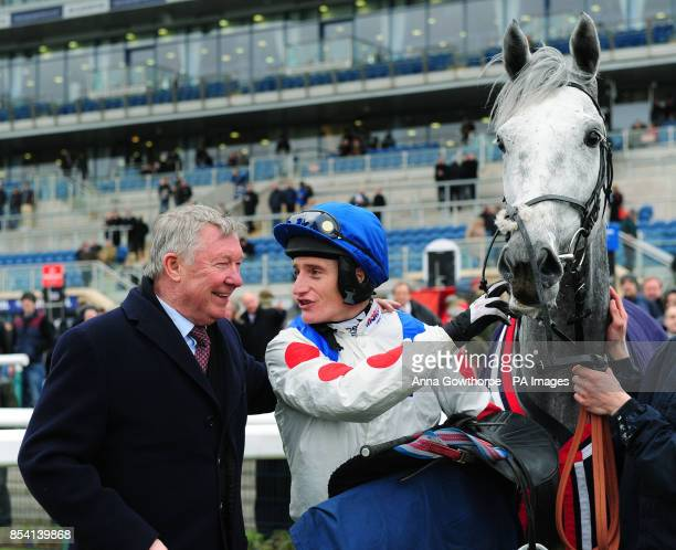 Sir Alex Ferguson with Empire Levant and jockey Daryl Jacob after their victory in the 32Red Novices' Steeple Chase during day one of the Grimthorpe...
