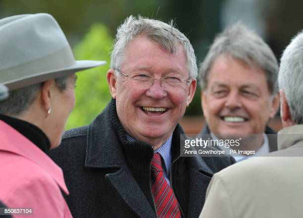 Sir Alex Ferguson with friends in the parade ring during Pertemps Swinton Hurdle Day at Haydock Park Racecourse NewtonLeWillows