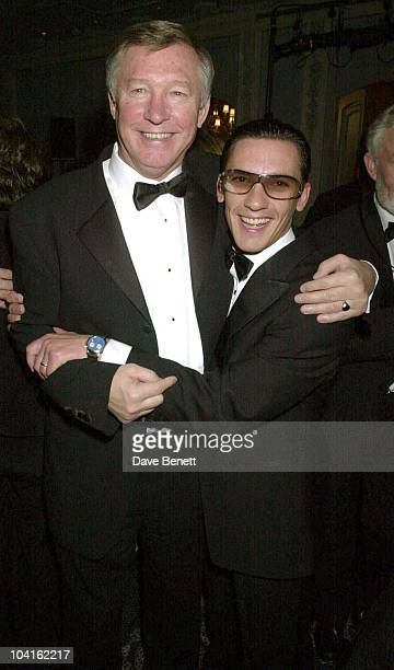 Sir Alex Fergusson Gets Caught By Jockey Frankie Dettori The 2001 Cartier Racing Awards Was Held At The Four Seasons Hotel London