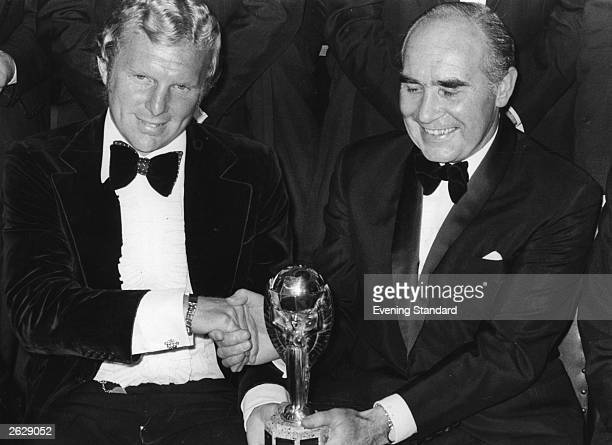 Sir Alf Ramsey England football manager with Bobby Moore England captain holding the Jules Rimet World Cup trophy after England's World Cup final...