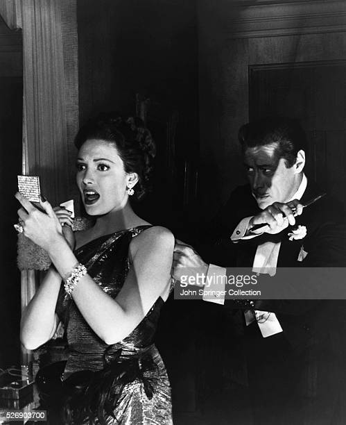 Sir Alfred De Carter attempts to sneak up behind his wife Daphne and attack her in a scene from the 1948 comedy Unfaithfully Yours