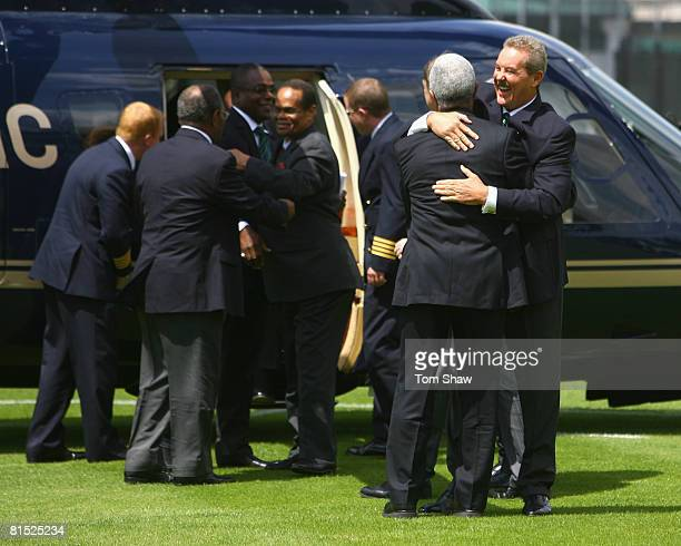 Sir Allen Stanford hugs Sir Garfield Sobers of the West Indies after arriving by helicopter on the nursery ground during the press conference for the...