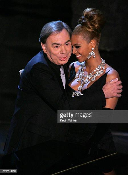 Sir Andrew Lloyd Webber hugs singer Beyonce Knowles on stage during the 77th Annual Academy Awards on February 27 2005 at the Kodak Theater in...