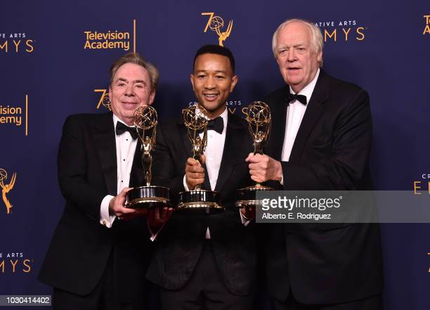 Sir Andrew Lloyd Webber John Legend and Tim Price pose in the press room during the 2018 Creative Arts Emmys at Microsoft Theater on September 9 2018...