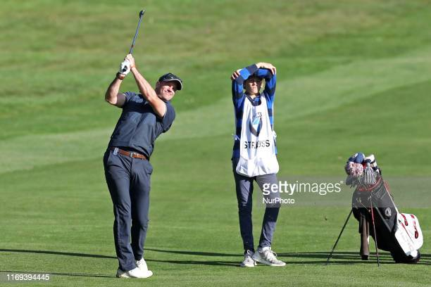 Sir Andrew Strauss with his son Sam caddying during the BMW PGA Championship Pro Am at Wentworth Club Virginia Water on Wednesday 18th September 2019