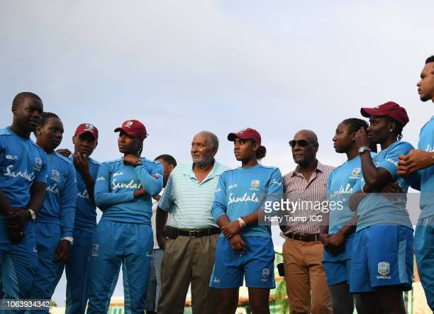 Sir Andy Roberts and Sir Vivian Richards look on alongside members of the West Indies side during a West Indies Net Session at Coolidge Cricket...