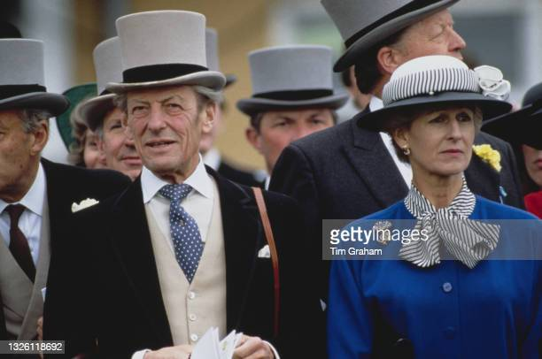 Sir Angus Ogilvy and Princess Alexandra, the Honourable Lady Ogilvy, at the Epsom Derby in Surrey, UK, 7th June 1989.