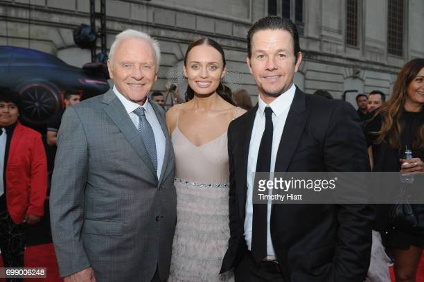 Sir Anthony Hopkins Laura Haddock and Mark Wahlberg attend the US premiere of 'Transformers The Last Knight' at the Civic Opera House on June 20 2017...