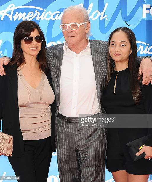 Sir Anthony Hopkins wife Stella Arroyave and niece attend the American Idol 2013 finale at Nokia Theatre LA Live on May 16 2013 in Los Angeles...