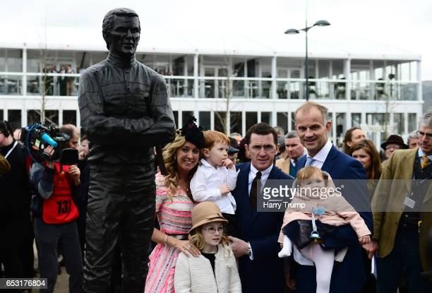 Sir AP McCoy poses with his wife Chanelle McCoy daughter Eve and son Archie and sculptor Paul Ferriter alongside a statue of himself which was...