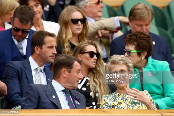 Sir Ben Ainslie and Lady Georgie Ainslie in discussion with Billie Jean King from the centre court royal box on day seven of the Wimbledon Lawn...