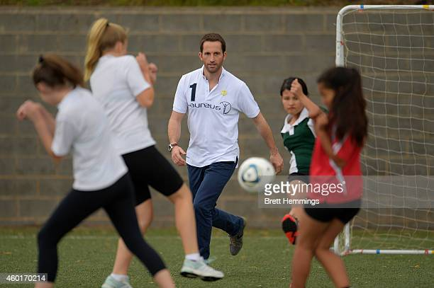 Sir Ben Ainslie interacts with school kids during his visit to Football United Festival supported by the Laureus Sport For Good Foundation on...