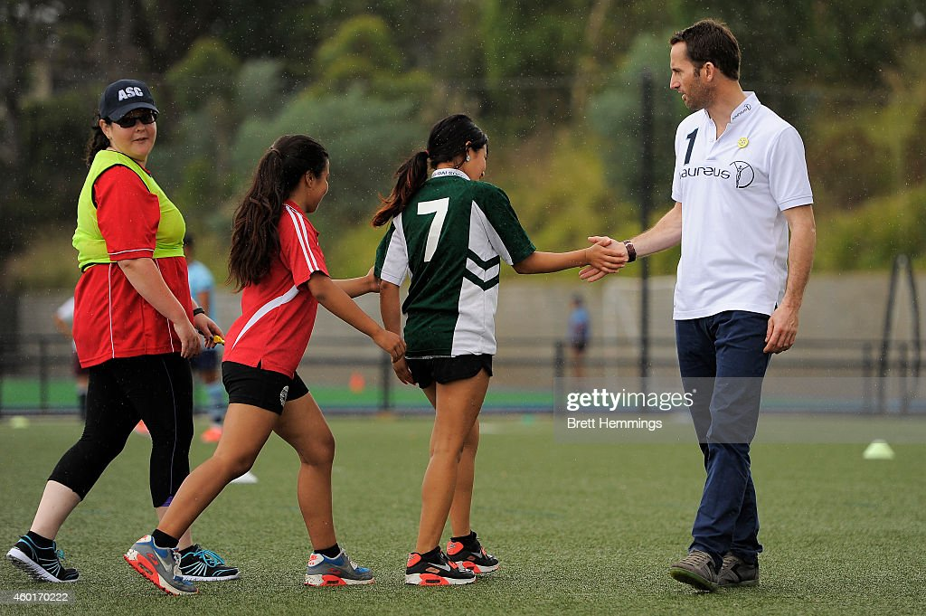 Sir Ben Ainslie interacts with school kids during his visit to Football United Festival supported by the Laureus Sport For Good Foundation on December 9, 2014 in Sydney, Australia.
