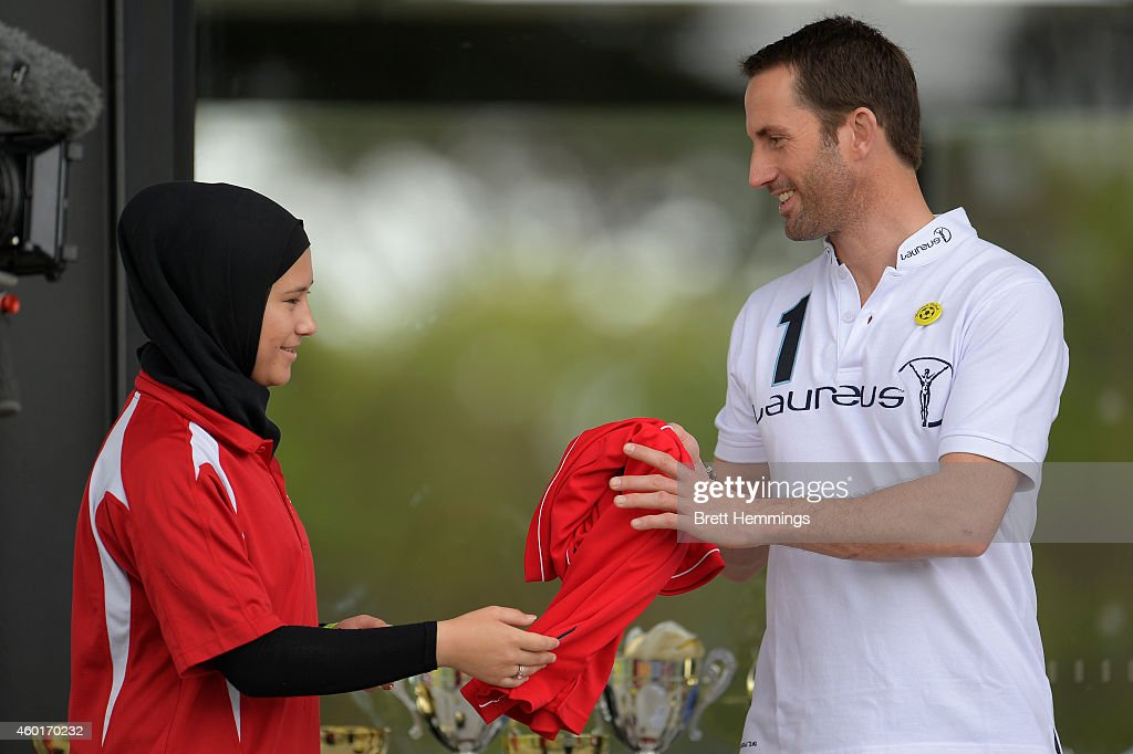 Sir Ben Ainslie is presented a Football United jersey during his visit to Football United Festival supported by the Laureus Sport For Good Foundation on December 9, 2014 in Sydney, Australia.
