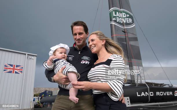 Sir Ben Ainslie skipper of LandRover BAR Lady Georgie Ainslie and their daughter Bellatrix pose during the launch and naming of the new Land Rover...