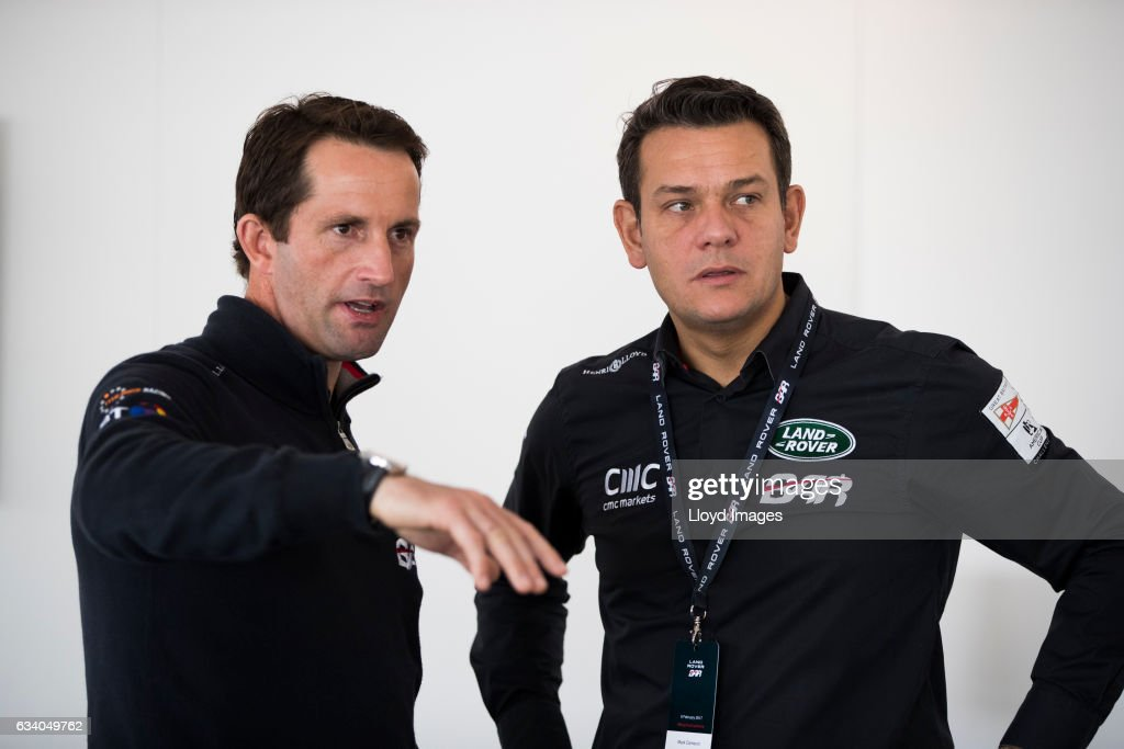 Sir Ben Ainslie talks with Land Rover Brand Experience Director, Global Marketing Mark Cameron prior to the launch of the teams new Land Rover BAR R1 race yacht 'RITA' on February 6, 2017 in Hamilton, Bermuda.