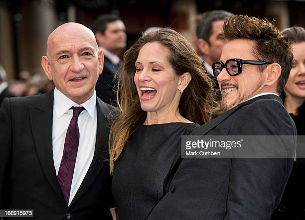 Sir Ben Kingsley Susan Downey and Robert Downey Jr attend a special screening of 'Iron Man 3' at Odeon Leicester Square on April 18 2013 in London...