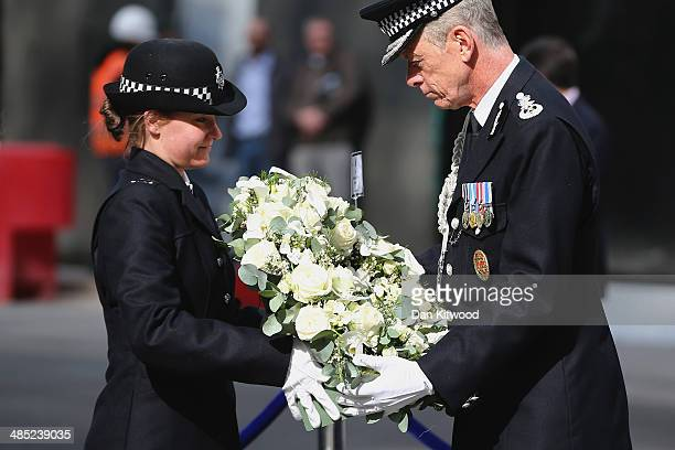 Sir Bernard HoganHowe the Commissioner of the Metropolitan Police lays a wreath during a memorial service for the murdered Police woman Yvonne...