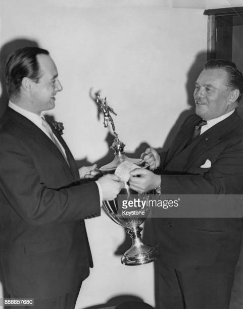 Sir Billy Butlin Chief Barker of the Variety Club of Great Britain presents a Challenge trophy and a cheque for £5000 to speedstar Donald Campbell at...