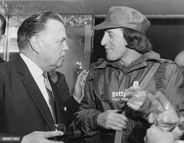 Sir Billy Butlin Chief Barker of the Variety Club of Great Britain with disc jockey Jimmy Savile at a Variety Club Golden Disc luncheon at the...