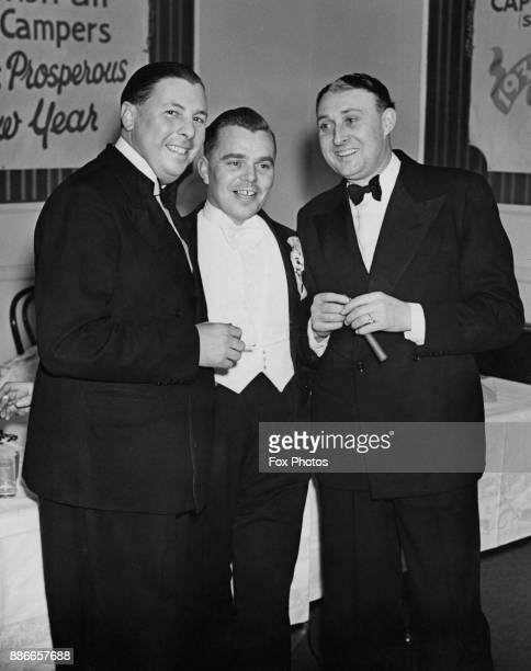Sir Billy Butlin hosts the Butlin's Skegness Grand Reunion Party at Olympia London 1st January 1937 He is pictured with guests Norman Long and...