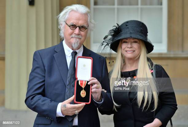 Sir Billy Connolly poses with his wife Pamela Stephenson after being knighted by the Duke of Cambridge during an Investiture ceremony at Buckingham...