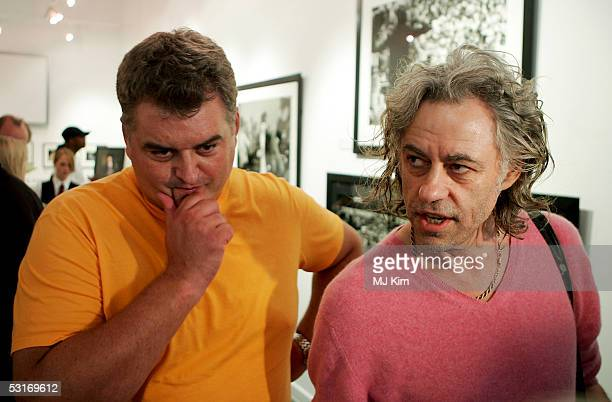 """Sir Bob Geldof and photographer Dave Hogan attend the """"Live Aid: Then & Now"""" private view at the Getty Images Gallery on June 29, 2005 in London,..."""