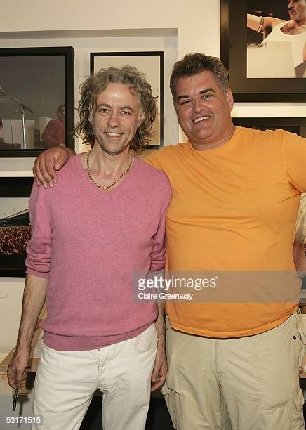 Sir Bob Geldof and photographer Dave Hogan attend the 'Live Aid Then Now' private view at the Getty Images Gallery June 29 2005 in London England The...