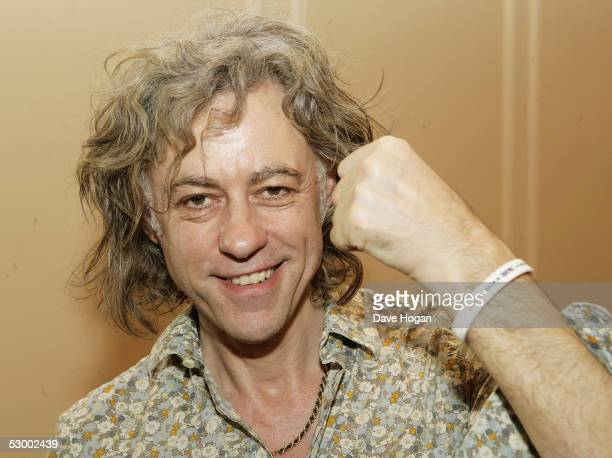 Sir Bob Geldof displays a MAKEpovertyHISTORY wristband after announcing details for the second Live Aid charity concert Live 8 to take place July 2...