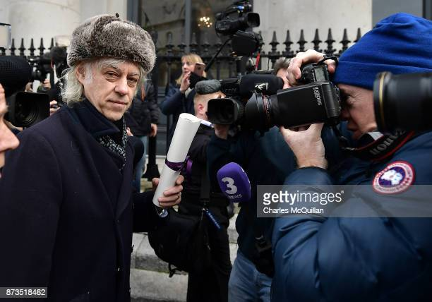 Sir Bob Geldof makes his way through a a large media pack as he hands back his freedom of Dublin city to Onnagh Casey Dublin City Manager's Office at...