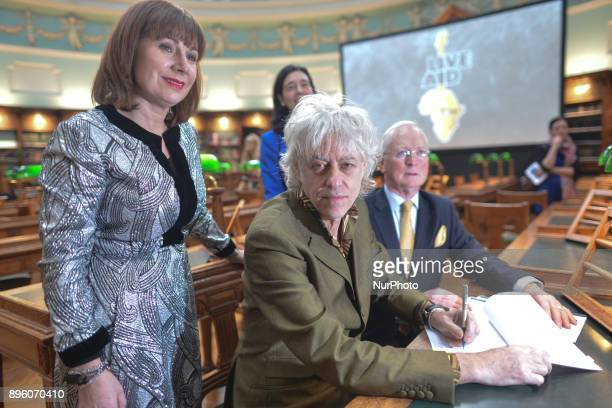 Sir Bob Geldof signs a contract at the National Library of Ireland in Dublin with Minister for Culture Heritage amp the Gaeltacht Josepha Madigan and...