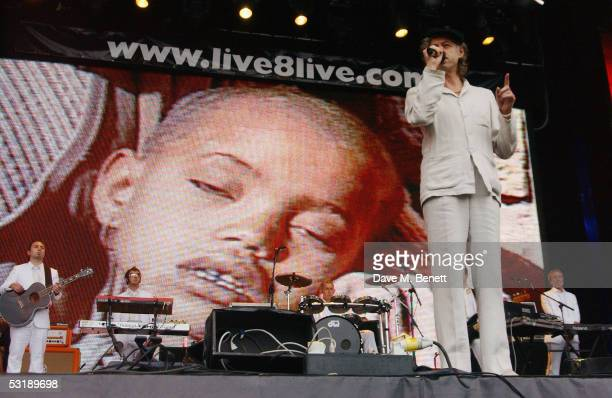 Sir Bob Geldof speaks on stage at 'Live 8 London' in Hyde Park on July 2 2005 in London England In the background is a video of the famine in...