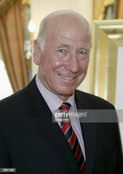 Sir Bobby Charlton and British artist Mackenzie Thorpe attend the annual Institute Of Directors Summer Sporting Lunch at the Royal Lancaster Hotel on...