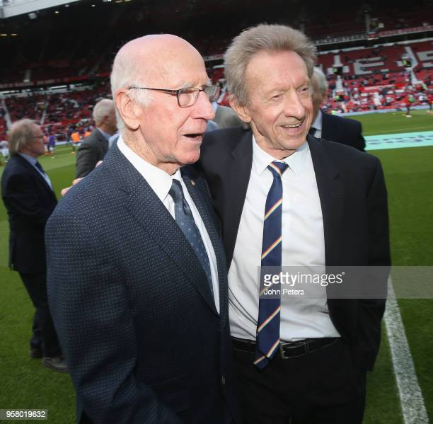 Sir Bobby Charlton and Denis Law meet ahead of the Premier League match between Manchester United and Watford at Old Trafford on May 13 2018 in...