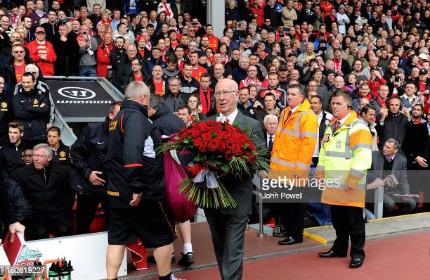Sir Bobby Charlton brings out flowers in honour of the Hillsborough tragedy before the Barclays Premier League match between Liverpool and Manchester...