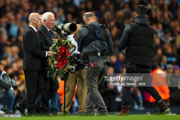 Sir Bobby Charlton carries out a wreath during the Premier League match between Manchester City and Manchester United at Etihad Stadium on November...
