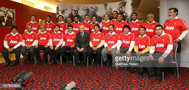 Sir Bobby Charlton poses with 23 of the freed Chilean Miners as they arrive at OldTrafford for an official reception and dinner on December 12 2010...