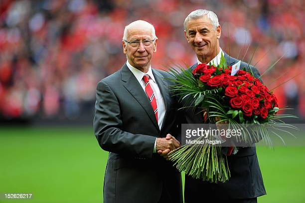 Sir Bobby Charlton presents Ian Rush with flowers before the Barclays Premier League match between Liverpool and Manchester United at Anfield on...