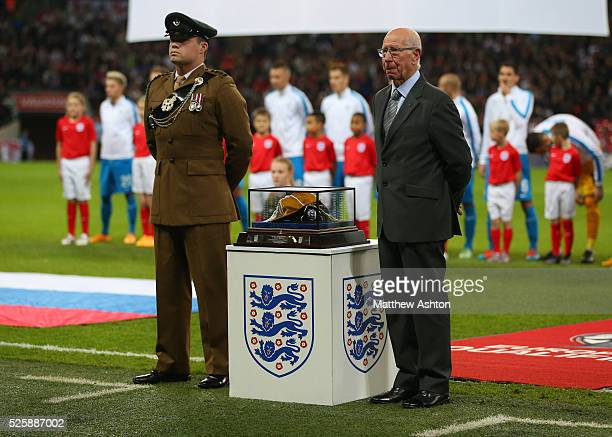 Sir Bobby Charlton stands next to the cap which was presented to Wayne Rooney of England to mark his 100th appearance