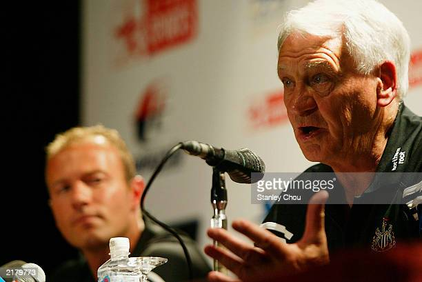 Sir Bobby Robson, manager of Newcastle United speaks to the press while captain, Alan Shearer looks on during a press conference held at the...