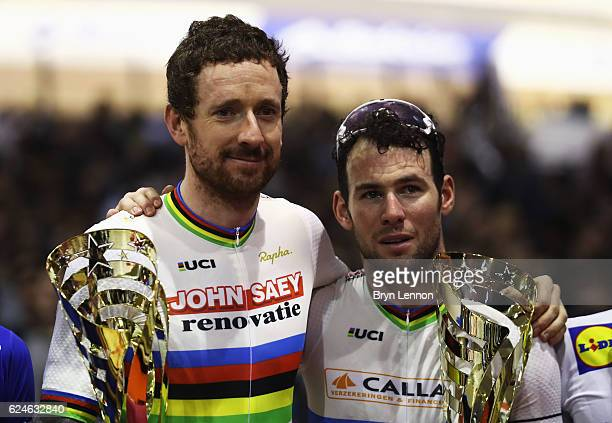 Sir Bradley Wiggins and Mark Cavendish of Great Britain and Team John Saey Callant pose with their trophies after victory during the final day of the...