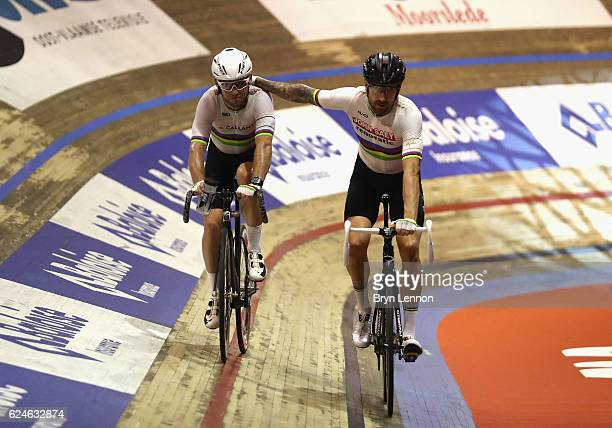 Sir Bradley Wiggins and Mark Cavendish of Great Britain and Team John Saey Callant celebrate during the final day of the 76th 6 Days of Gent race at...