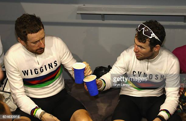 Sir Bradley Wiggins and Mark Cavendish of Great Britain and Team John Saey - Callant celebrate victory with a drink after the final day of the 76th 6...