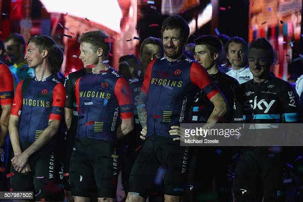 Sir Bradley Wiggins leader of Team Wiggins looks on as ticker tape falls during a team presentation show ahead of the Tour of Dubai at the Westin...