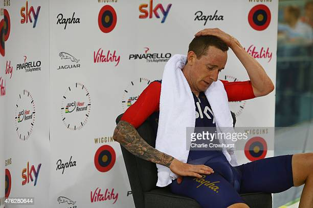 Sir Bradley Wiggins of Great Britain and Team Wiggins recovers after breaking the UCI One Hour Record at Lee Valley Velopark Velodrome on June 7 2015...