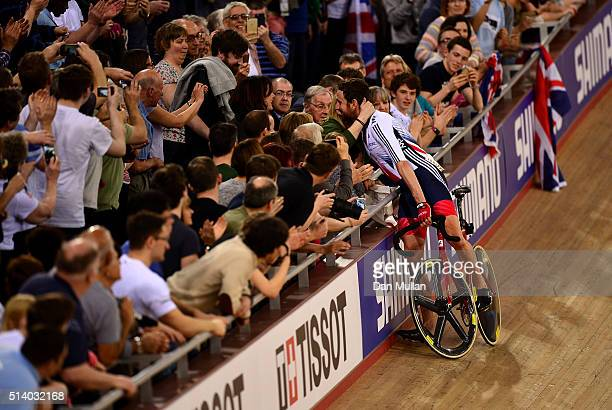 Sir Bradley Wiggins of Great Britain celebrates winning the Mens Madison Final with his family during Day Five of the UCI Track Cycling World...