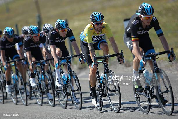 Sir Bradley Wiggins of Great Britain riding for Team Sky follows the wheel of teammate Christian Knees of Germany riding for Team Sky as Wiggins...